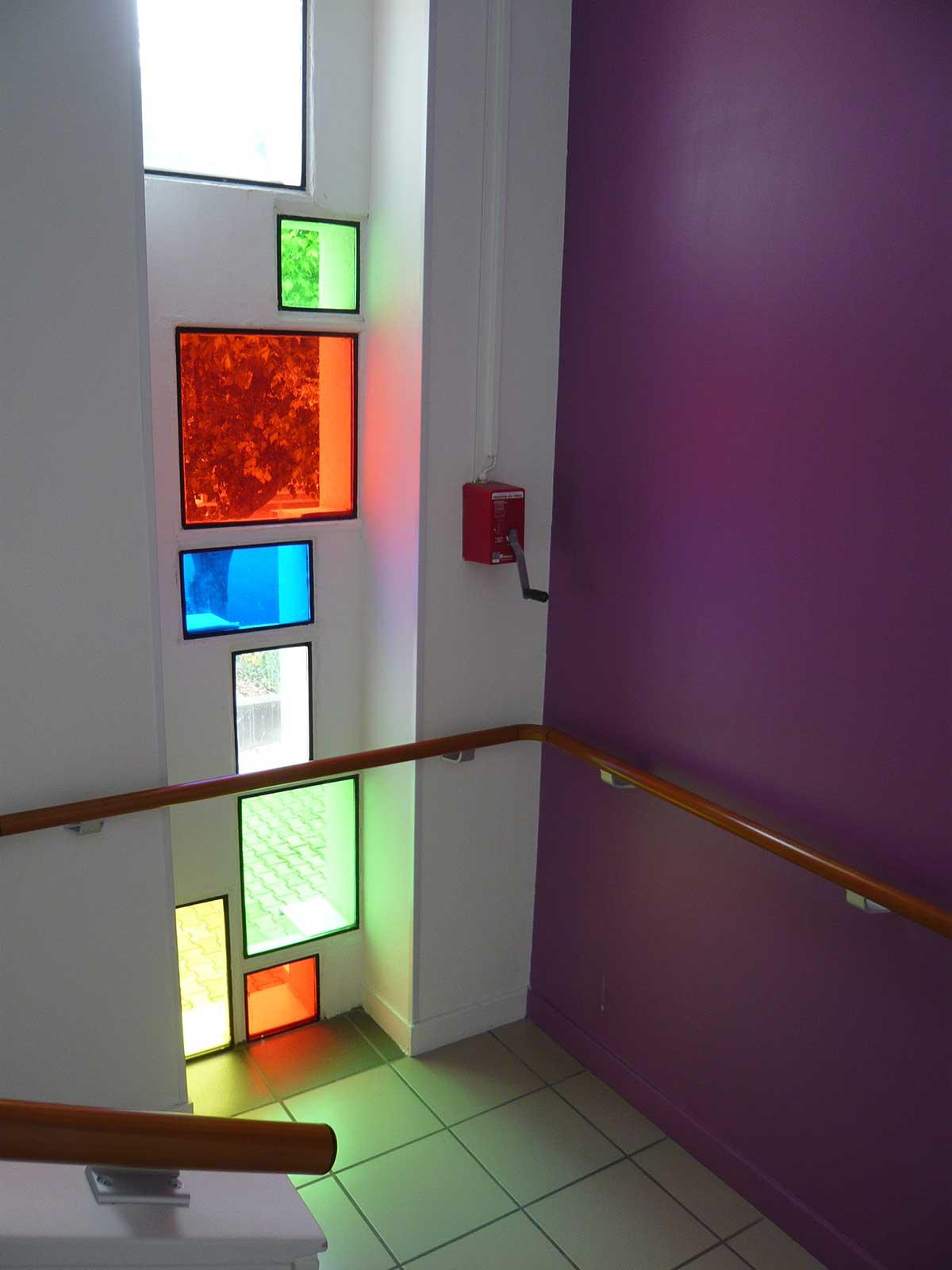 Escalier et ses vitraux